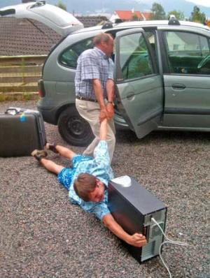 dad drags kid away from computer