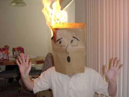 bag on head in flames